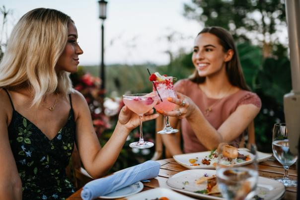 Two ladies toasting pink cocktails at Prime at Saratoga National