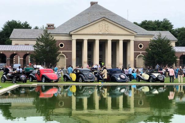 Bugattis displayed and reflected around Saratoga reflecting pool