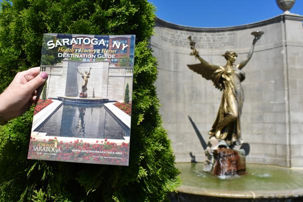 2018 Saratoga Destination Guide in front of Spirit of Life