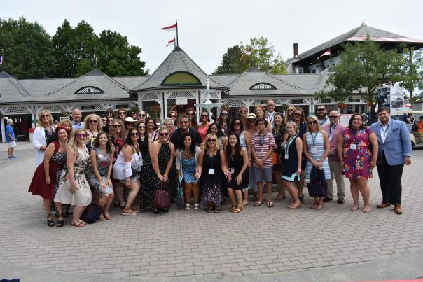 Large group in front of the Saratoga Race Course entrance