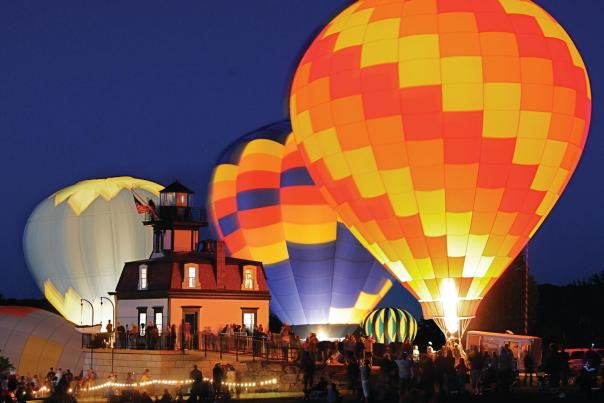 Balloons at night during Saratoga Balloon & BBQ Festival