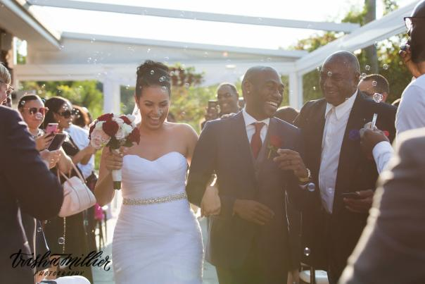 Trisha Millier photo of bridal couple being congratulated with bubbles