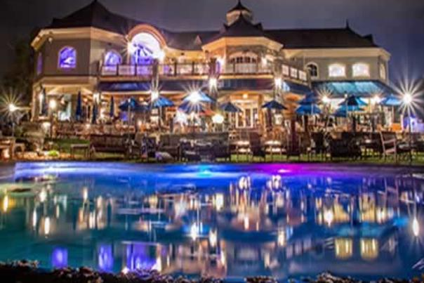 Saratoga national patio and water fountain at night lit up