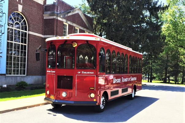 Red Saratoga Trolley in front of the Automobile museum