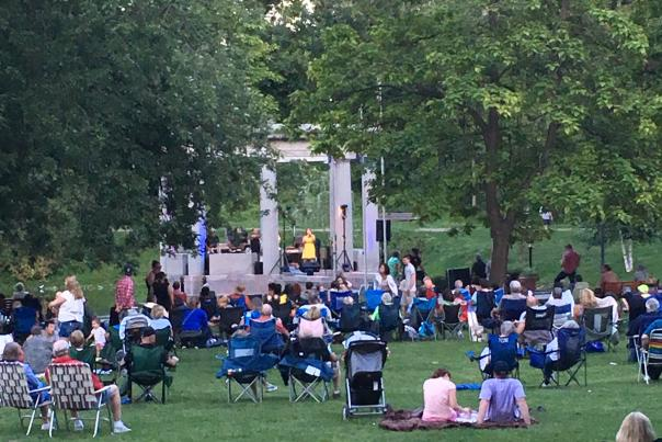 People enjoying a concert in congress park