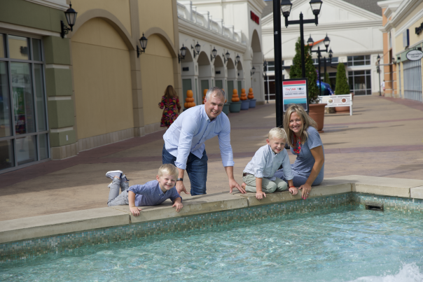 Family by a fountain
