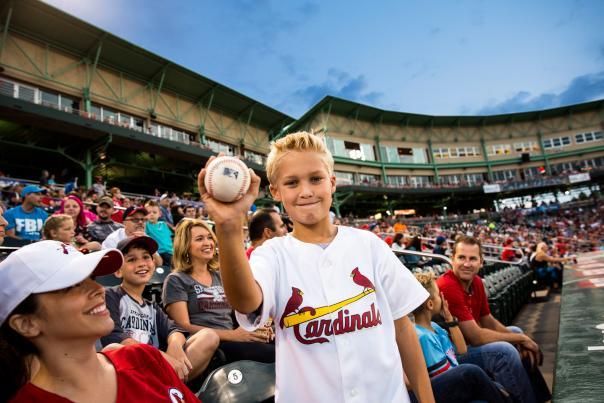 Boy holding baseball at Springfield Cardinals Game