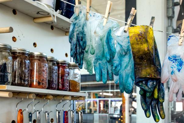 Gloves, Dye, and Tools in Lydia Crespo's studio