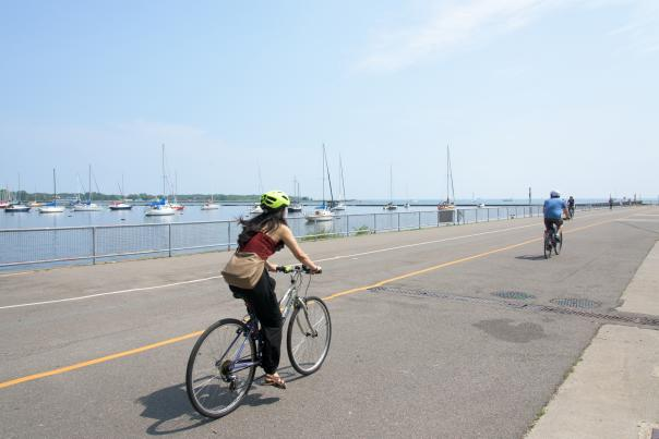 People ride bikes on the Martin Goodman Trail along Toronto's waterfront in summer
