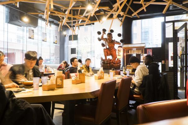 People eat in a restaurant in Toronto's Koreatown