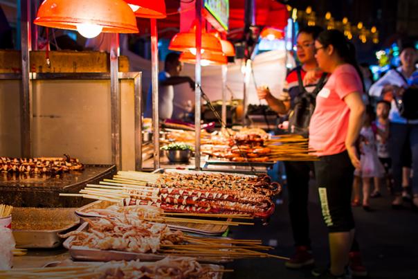 Street-food-skewers-at-food-stall-scaled