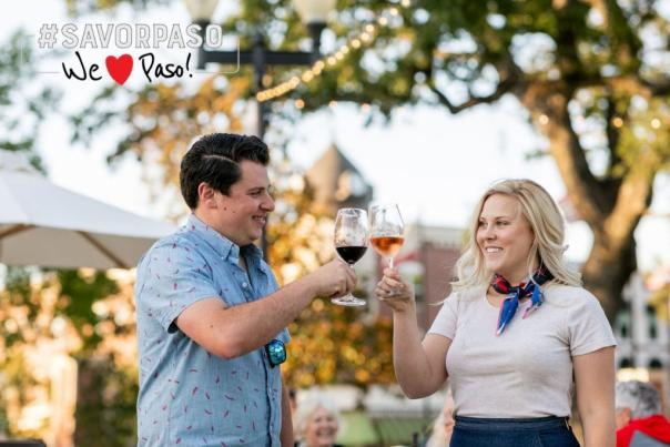 Cheers with wine in park
