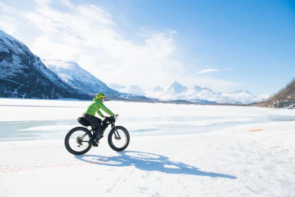 a fat bike rider on a snowy plain in Valdez, Alaska