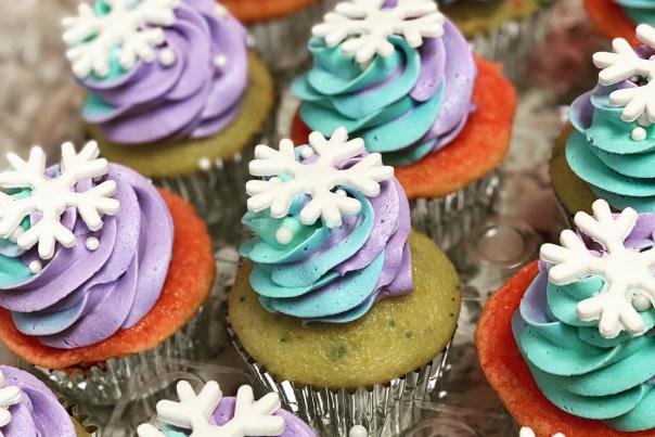 blue and purple swirl cupcakes with a snowflake on top