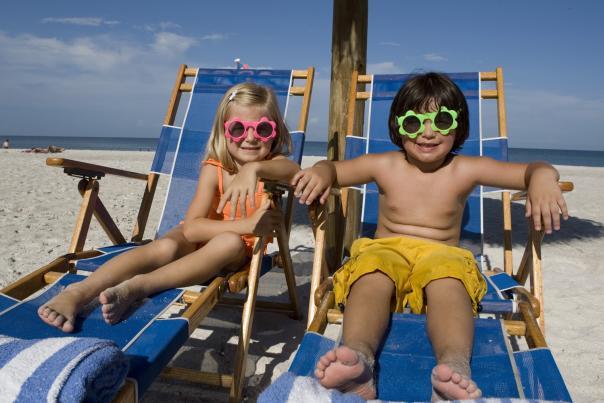 1267660529_naples-beach-hotel--golf-club----kids-on-beach.jpg