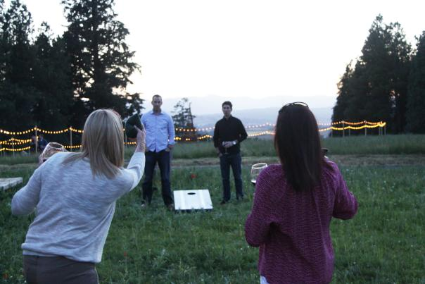 Twilight game of corn hole at the winery