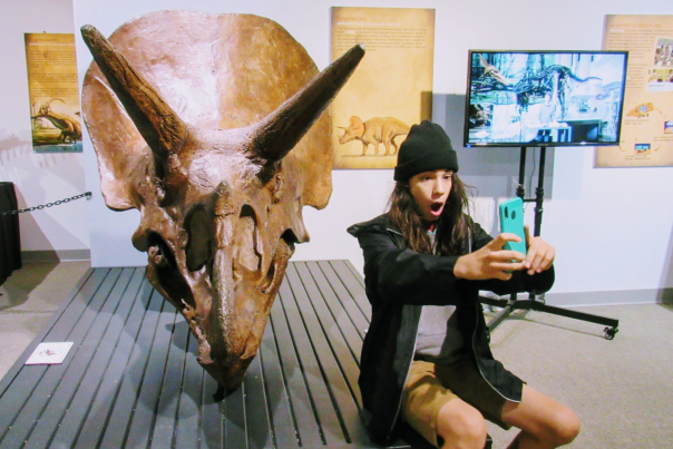 Selife with the dino exhibit at Cape Fear Museum
