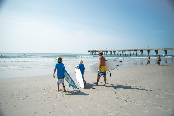 Family and friends going surfing at Wrightsville Beach