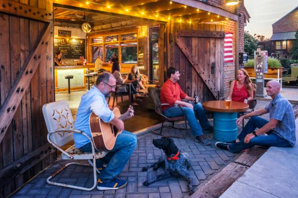 People Playing Guitar And Enjoying A Beer Outside Of A Brewery In Wilmington, DE
