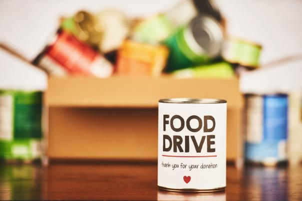 Food Drive Canned Goods Collection with Filled Cardboard Box