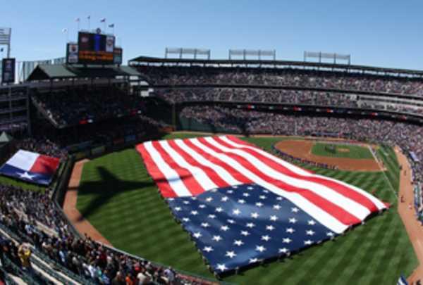 An American flag spread across the field at Globe Life Park in Arlington, TX