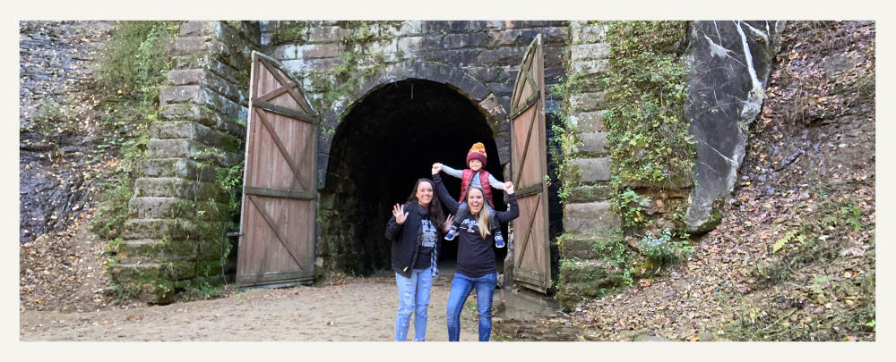 Family Standing In Front Of Elroy-Sparta State Trail Tunnel 3 in Sparta, WI