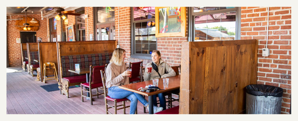 Two Women Having A Beer At Northwoods Brewpub in Osseo, WI