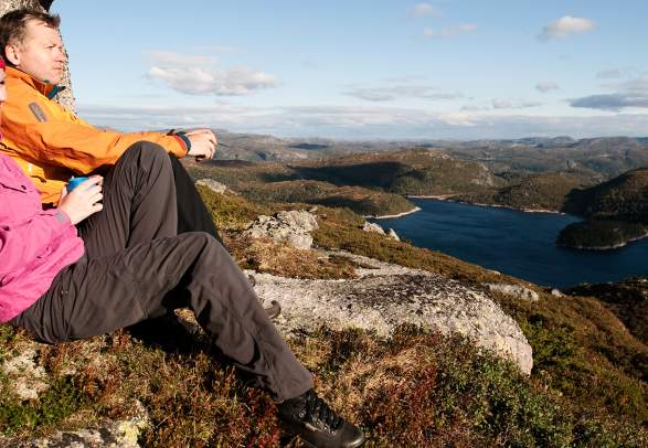 Two people enjoying the view of Sirdal's mountain landscape
