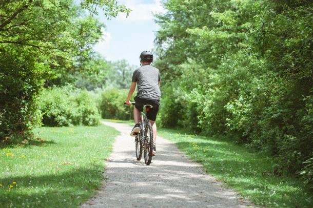 Man riding on trail