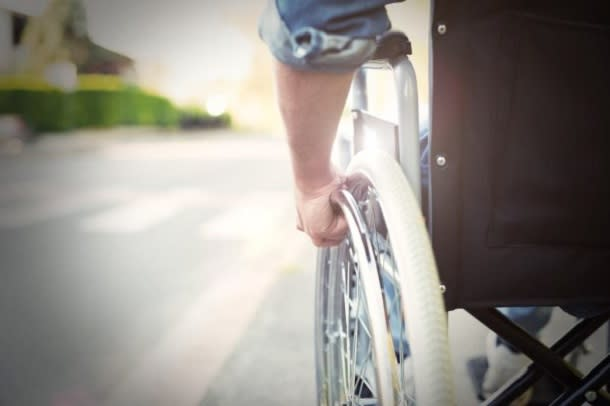 man in on path in wheelchair