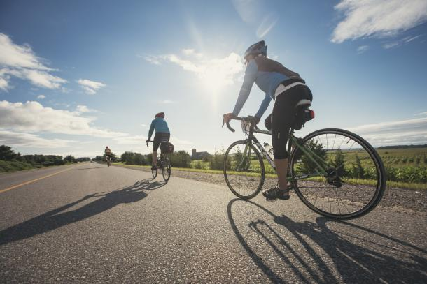 2 people on road cycling