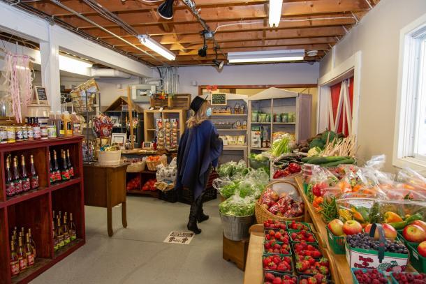 woman at market buying produce