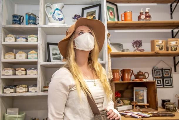 woman shopping in store with mask on