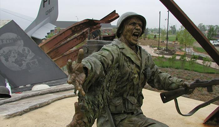 A bronze statue of a soldier is one of many installations at the Community Veterans Memorial in Munster, IN.