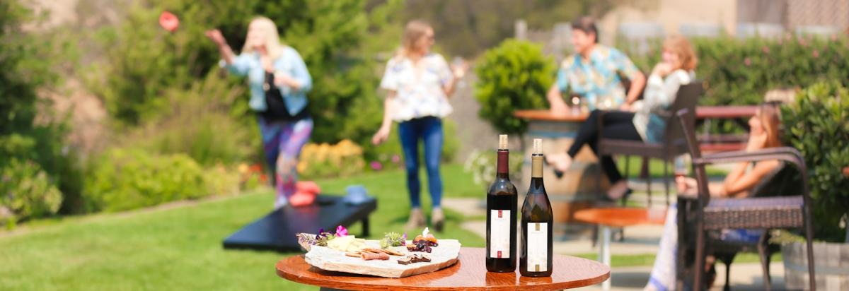 Wine from Harmony Cellars featured in a backyard get together in SLO CAL
