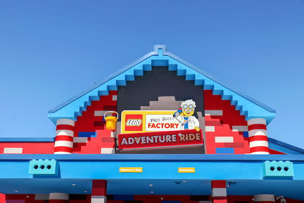 The outside of Legoland's Factory Adventure Ride marked by a sign