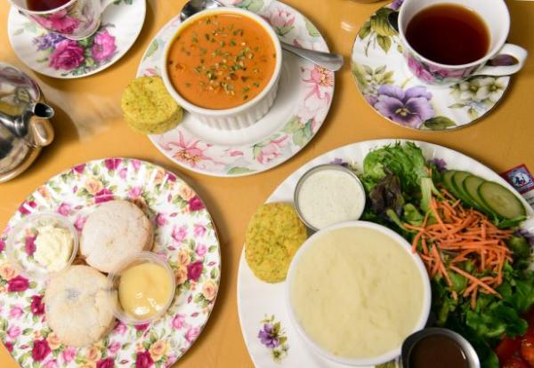 A spread of soups, salads, and pastries on flowered plates from the English Tea Room