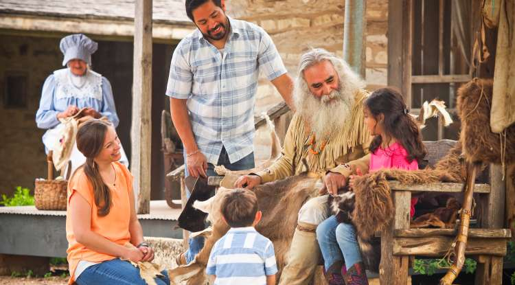 Close Up of Family Under Tree at Pioneer Museum