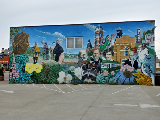 Street art in Newport Kentucky depicting famous people and places from the area in one art mural