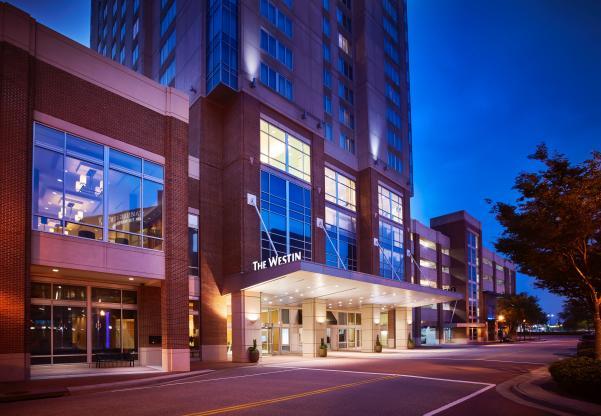Light illuminate the entrance to Westin Hotel Virginia Beach Town Center.