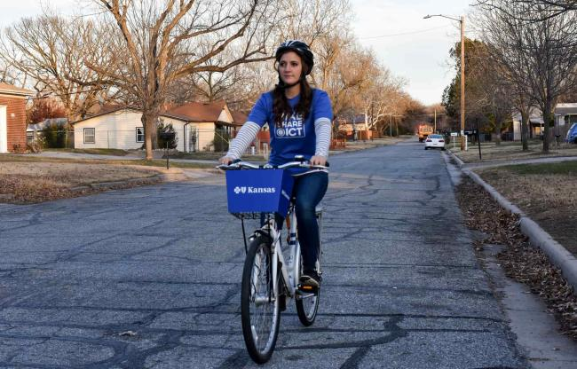 Riding a Bike Share ICT Bicycle Down the Street