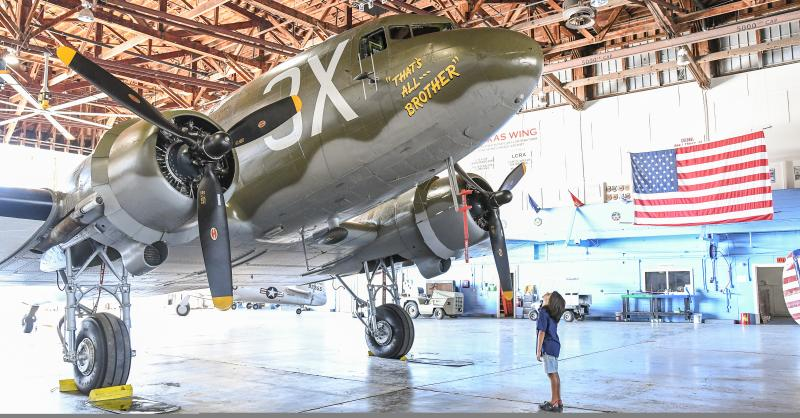 Boy looking up at WWII bomber