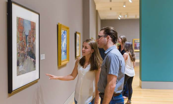 Couple enjoying artwork in a Columbia SC gallery