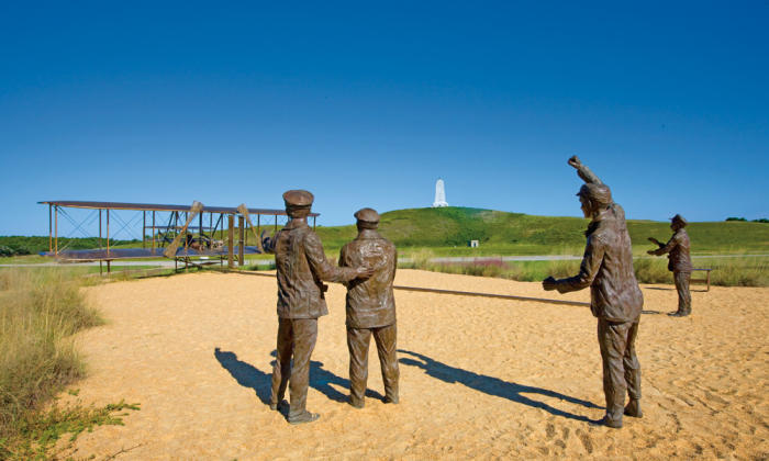 Bronze statue of the Wright Brothers Memorial First Flight in Kill Devil Hills in the OBX