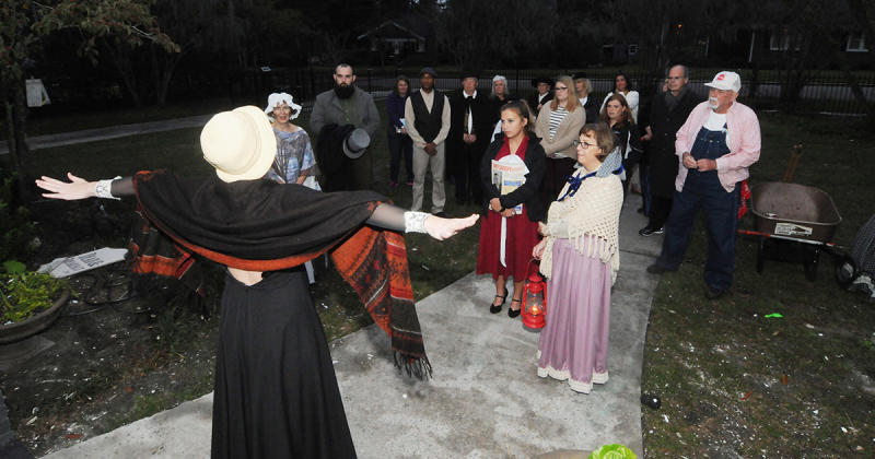 A woman in costume stands before a crowd during the annual Conway Ghost Walk