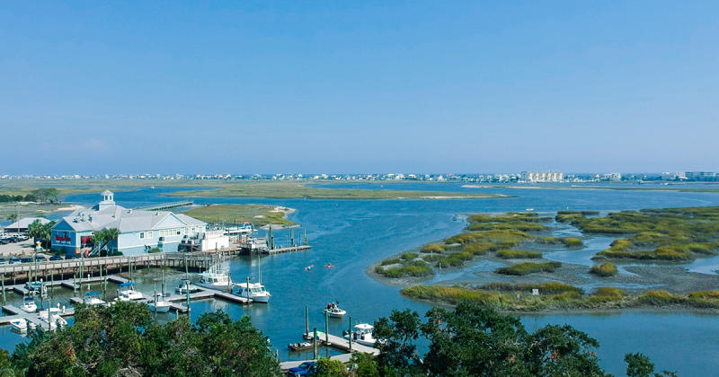Aerial of Murrells Inlet with marsh, marina and beach homes