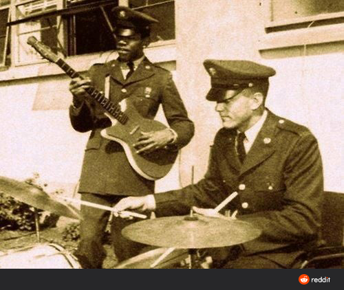 guitarist and drummer in Army uniforms
