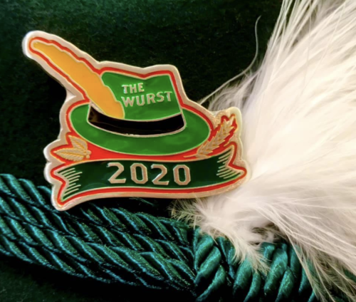 "A 2020 commemorative German hat-shaped hat pin that reads ""The Wurst"""