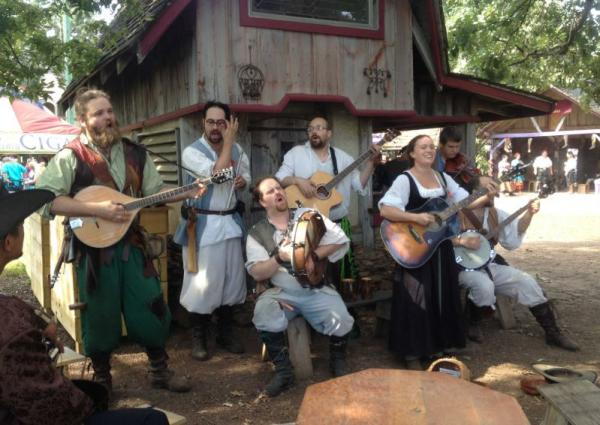Musicians dressed in Renaissance style clothing perform in front of an old-style building during the Renaissance Festival Oktoberfest Weekend