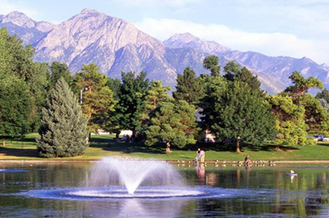 Lake at Liberty Park with view of mountains